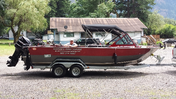 Picture of Marvin leaning on his covered and heated fishing boat as it sits on his trailer